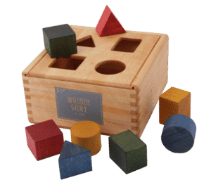 Shape sorting box - wooden story