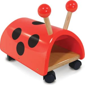 Wooden ride on toy. Red with black spots on seat and 4 black coaster wheels
