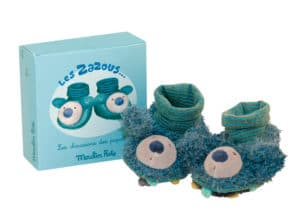 Blue slipper with toy face on toes. Blue gift box