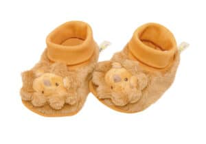 Yellow slipper with Lion toy head on toes